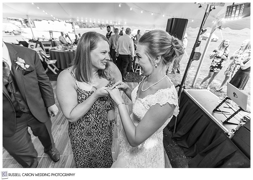 black and white photo of bride talking to a woman
