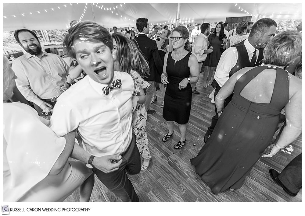 black and white photo of man on a dance floor