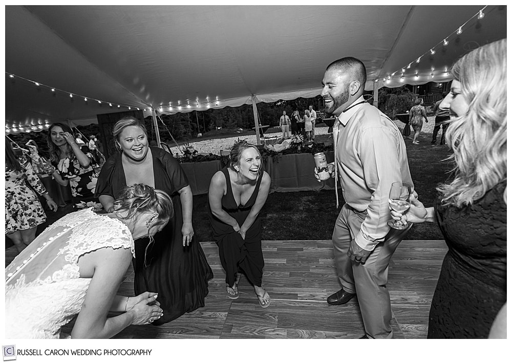black and white photo of people laughing and dancing