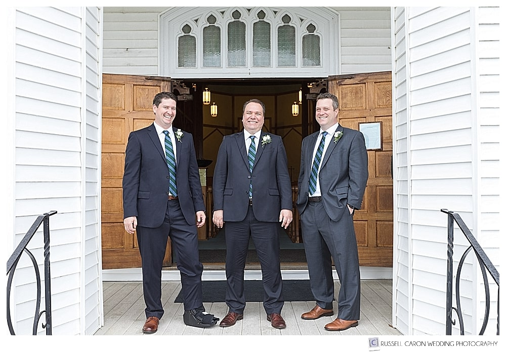 groom and groomsmen on the steps of the church
