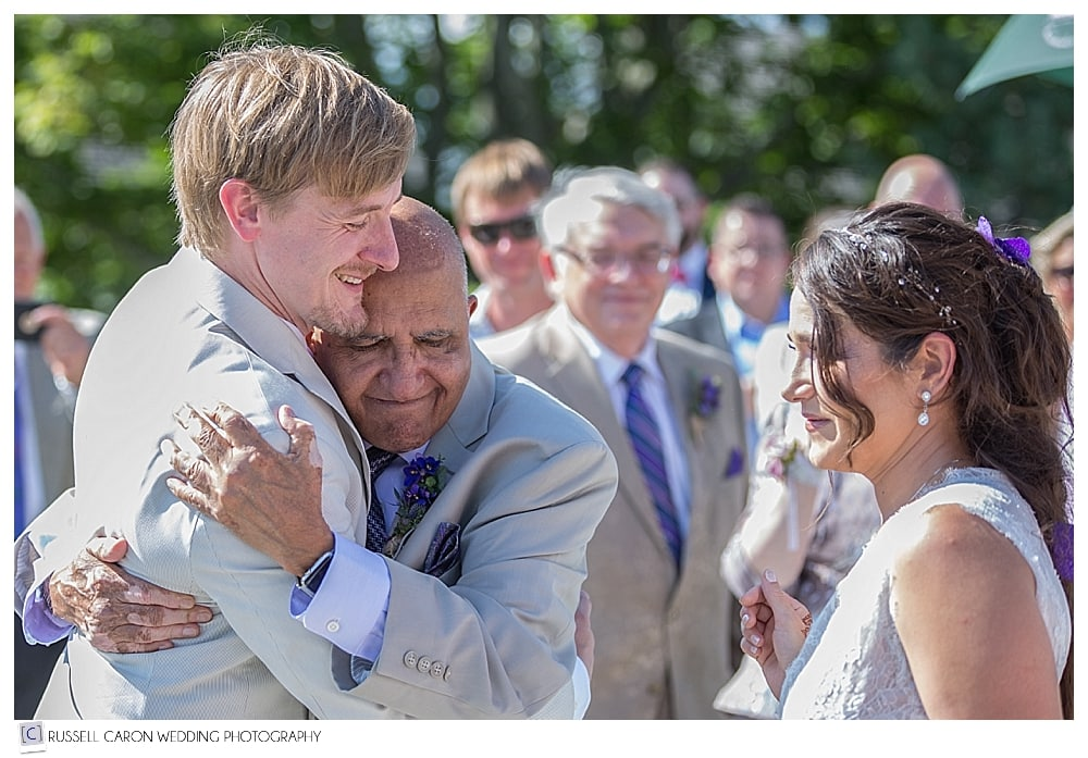 #4 of our touching wedding photos, the bride's father hugging the groom just before the ceremony