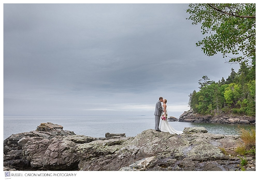 Bride and groom on the coast of Bar Harbor Maine
