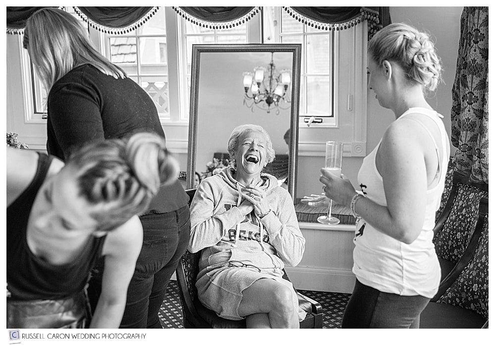 mother of the bride laughing during bridal prep