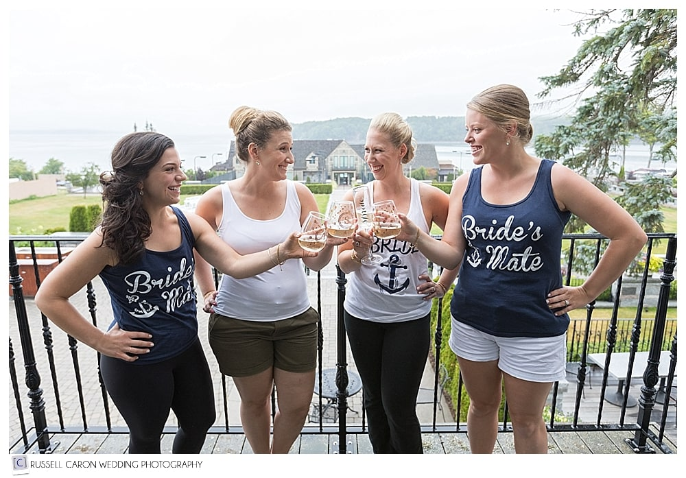 bride and bridesmaids having a champagne toast