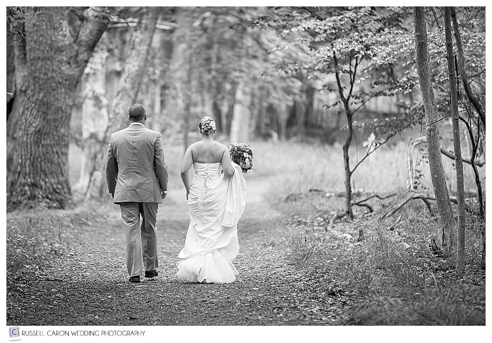 bride and groom walking along a path in Acadia National Park, Bar Harbor, Maine