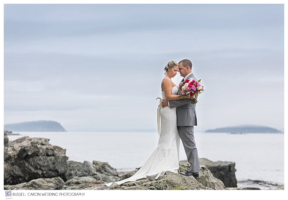Bride and groom in a quiet embrace at Acadia National Park