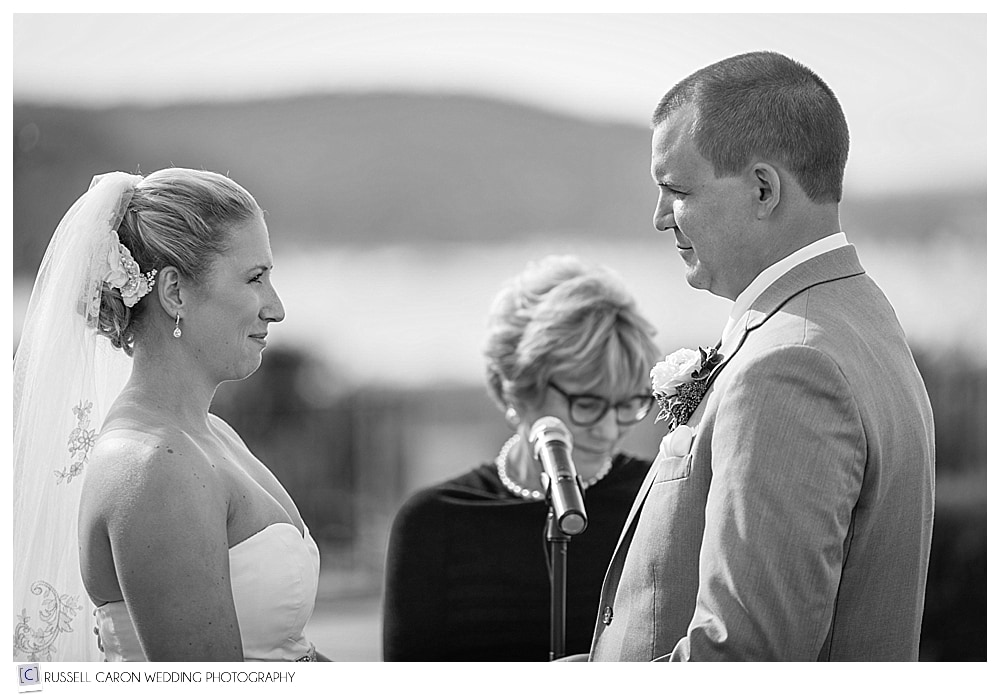 Bride and groom looking at each other during their outdoor wedding ceremony at the Bar Harbor Club, Bar Harbor Maine wedding