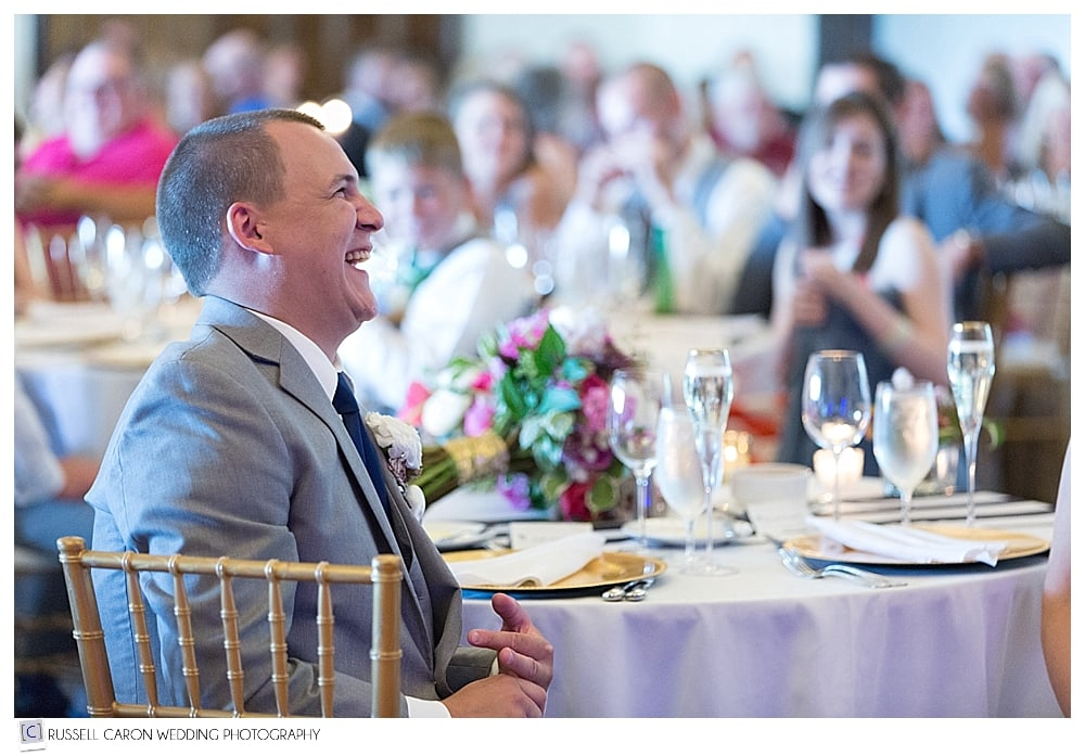 groom laughing during wedding ceremony