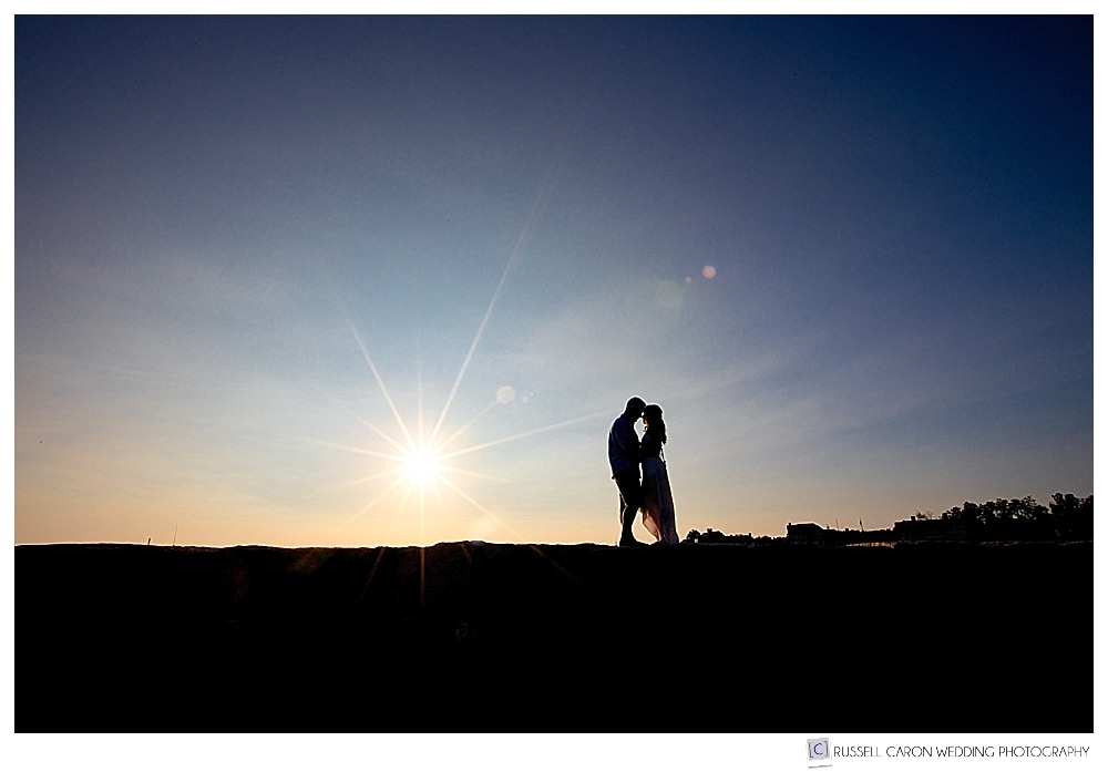 couple standing together on Kennebunkport Breakwater during sunset, Kennebunkport, Maine