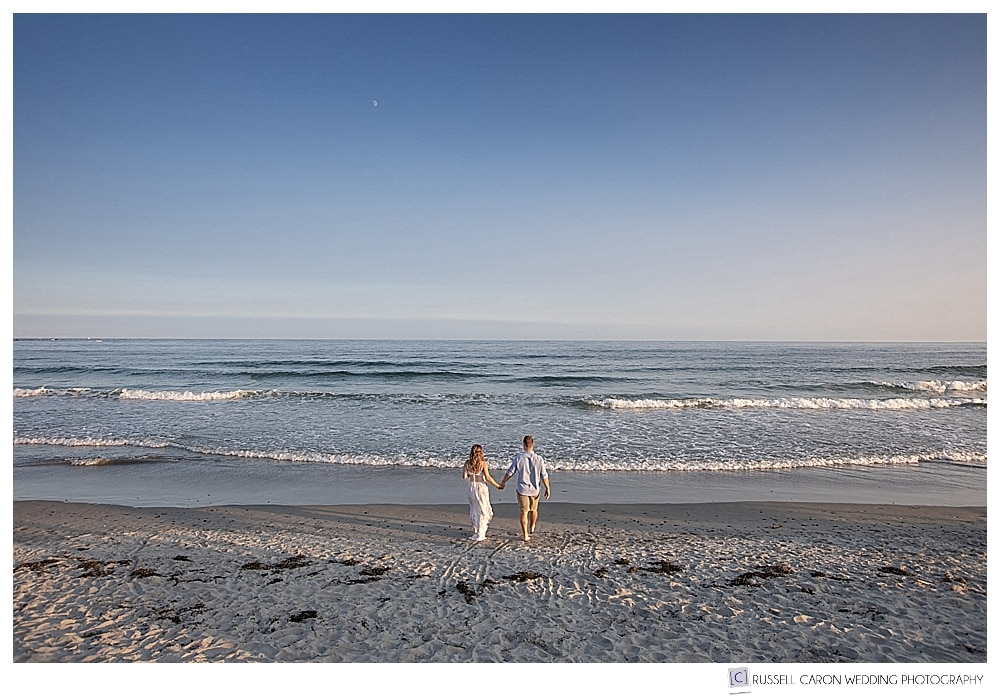 Couple walking on Mother's Beach, Kennebunk, Maine, during their Kennebunkport Maine engagement session