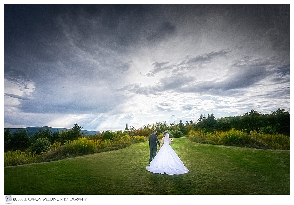 bride and groom walking at the summit of Point Lookout Resort Northport Maine