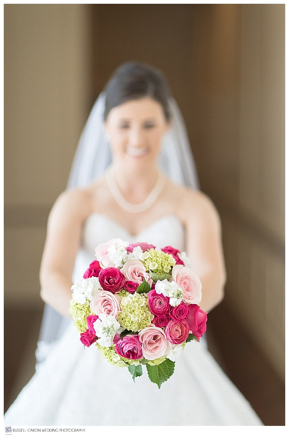 bride with beautiful bridal bouquet from Seasons Downeast Designs