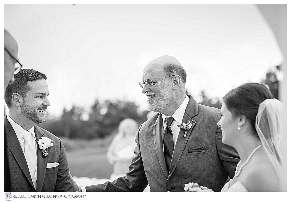 father of the bride, shakes the groom's hand
