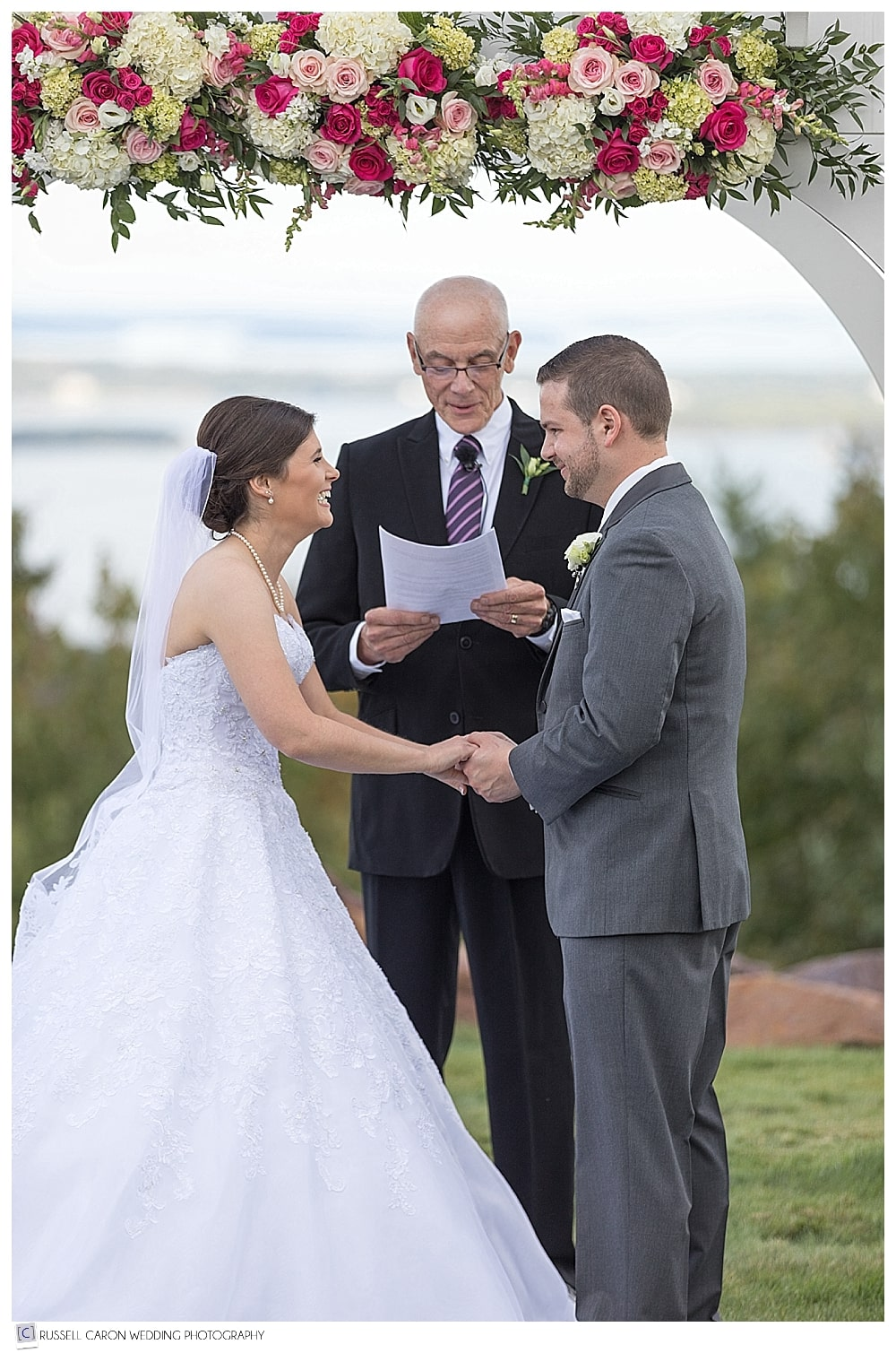 Bride and groom during beautiful Point Lookout wedding ceremony, on the lawn in Northport, Maine