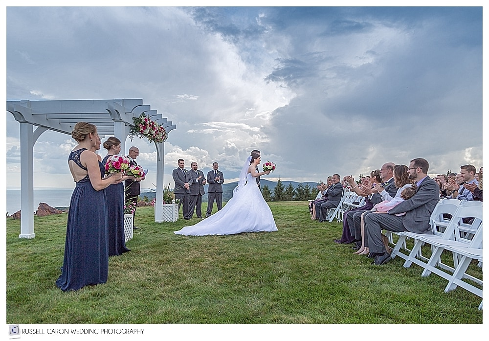 bride and groom during their recessional from beautiful Point Lookout wedding, Northport, Maine