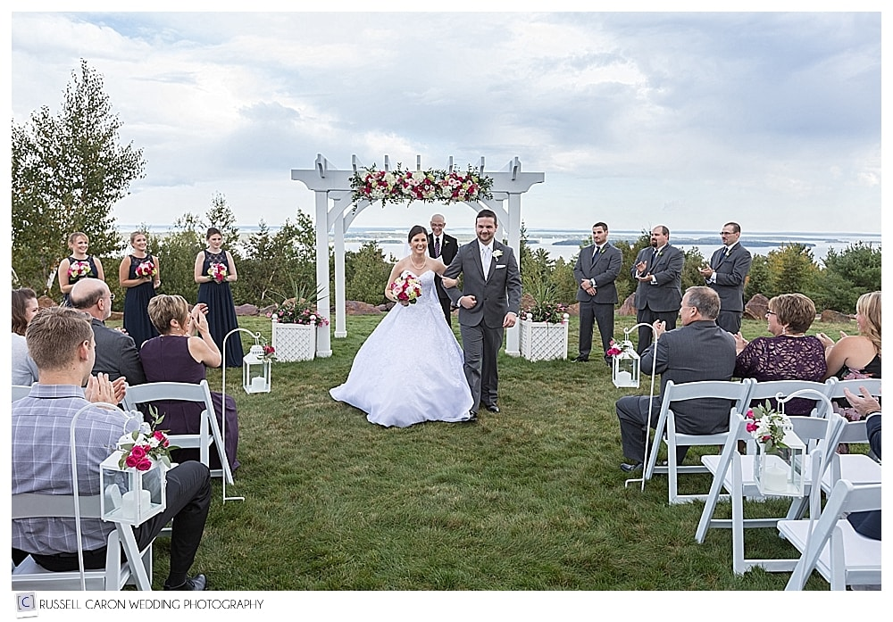 bride and groom during recessional at outdoor wedding at Point Lookout, Northport, Maine