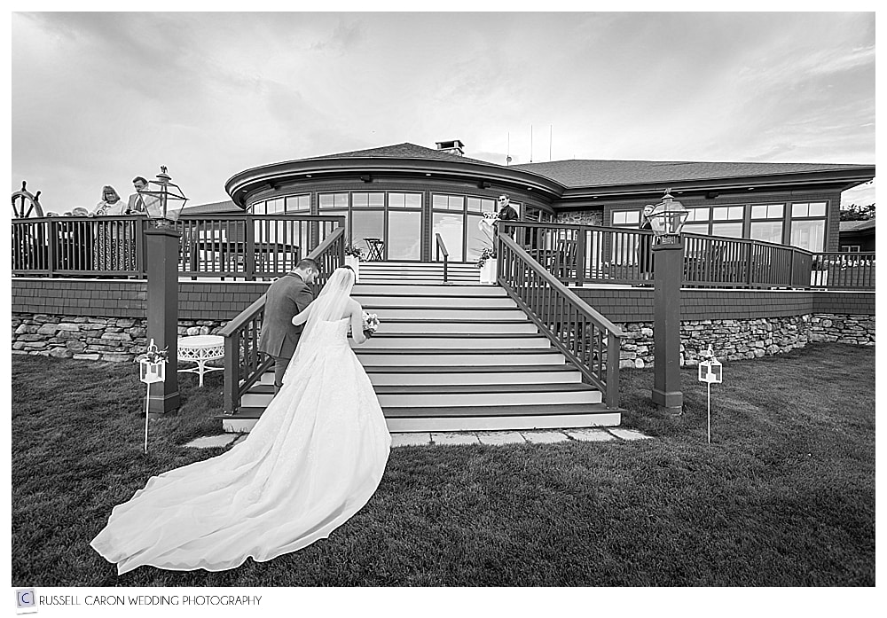bride and groom walking up the stairs to the porch at Point Lookout, Northport, Maine