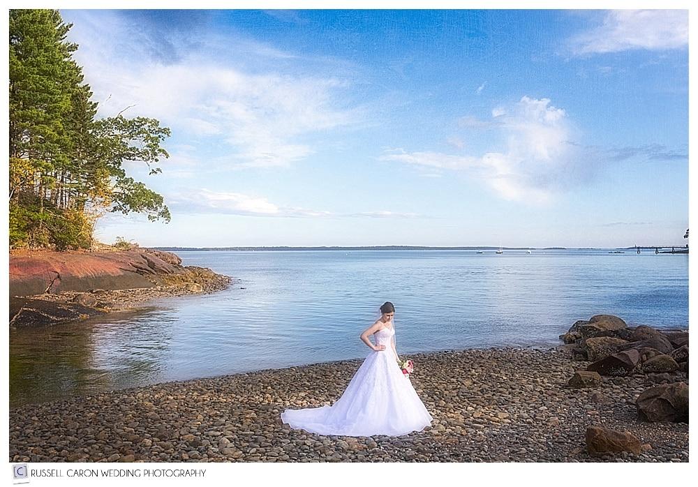 beautiful photo of bride on a rocky Maine beach