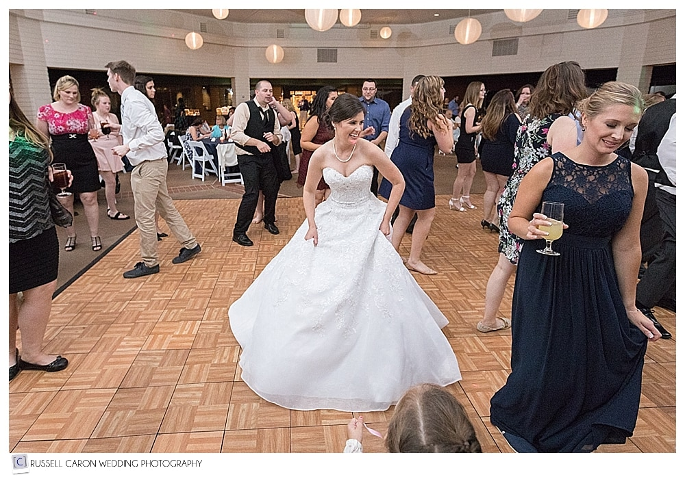 bride dancing during wedding reception at the Pavilion at Point Lookout
