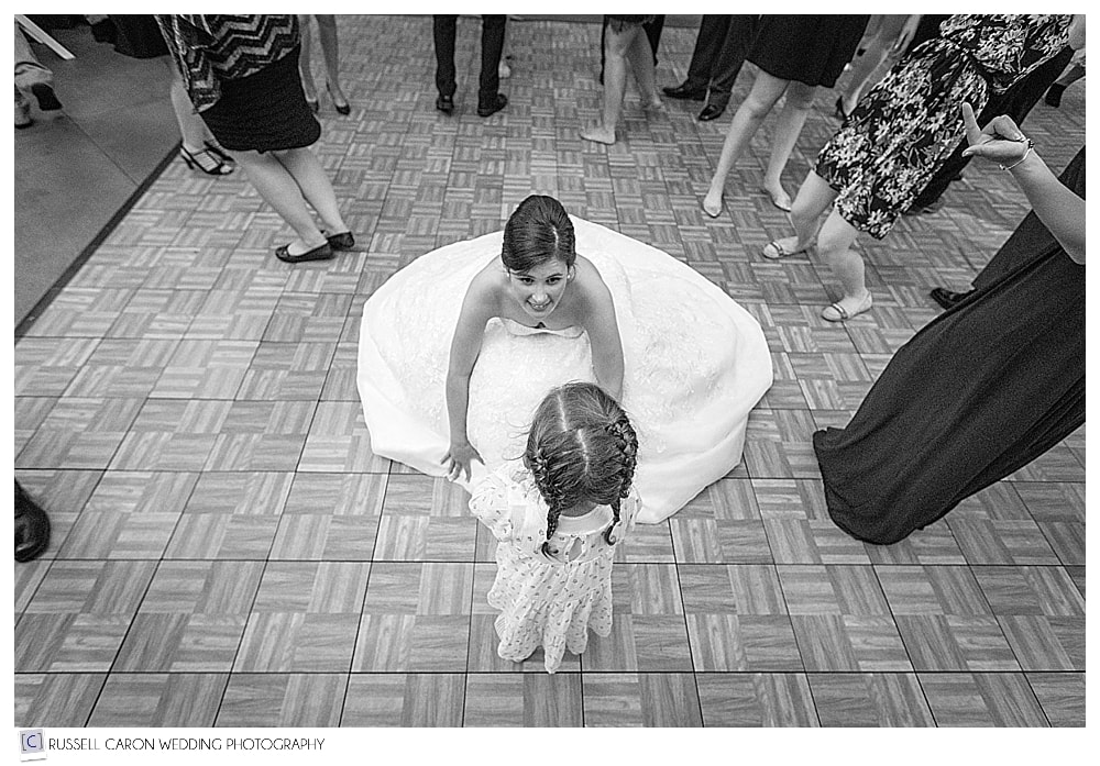 bride dancing with little girl