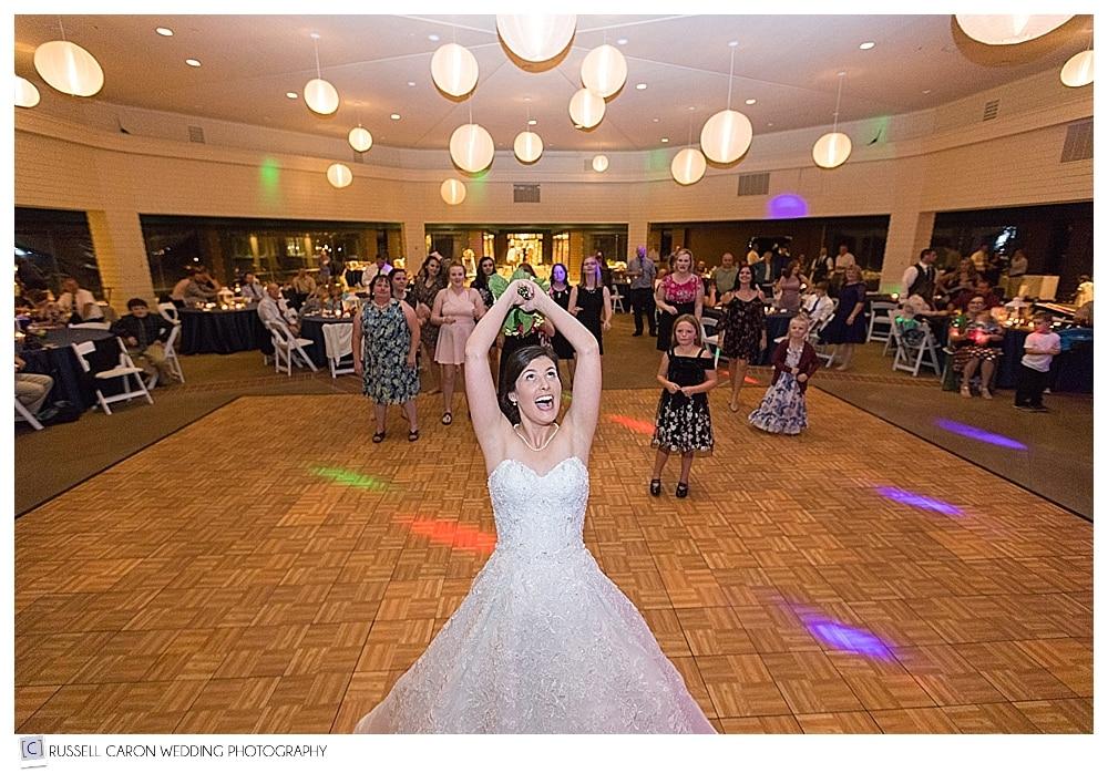 bride during bouquet toss