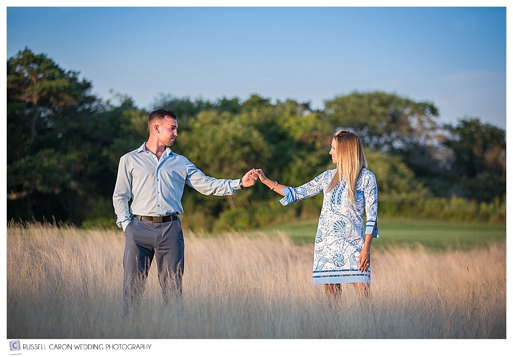 man and woman dancing in a field