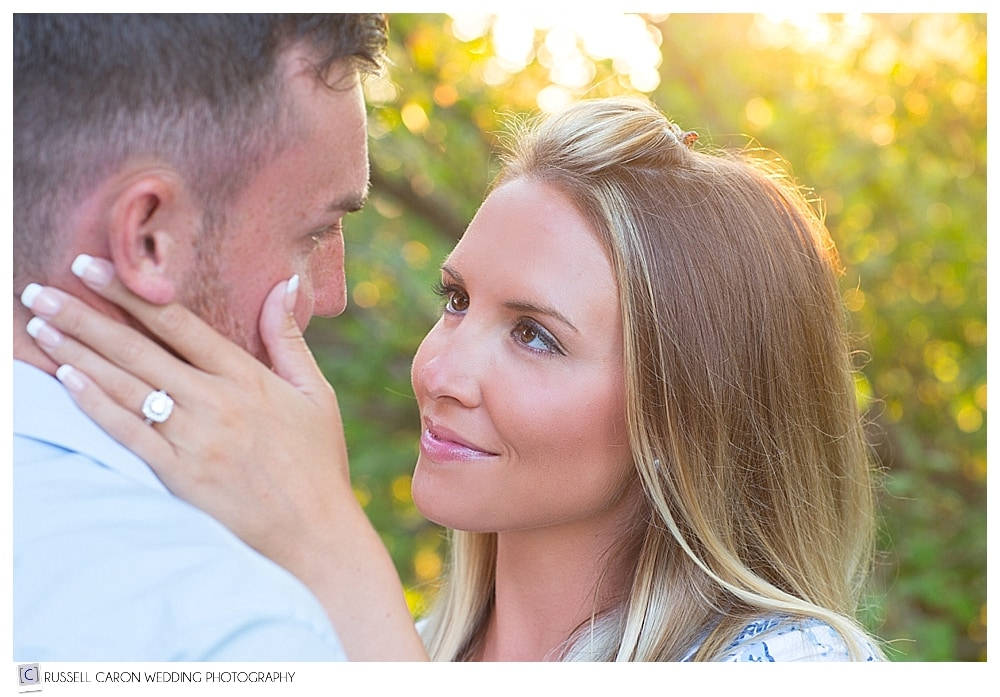 engaged couple looking into each other's eyes