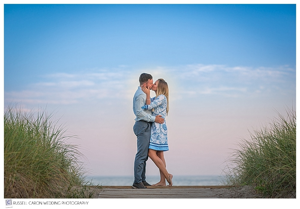 couple kissing in the sand dunes