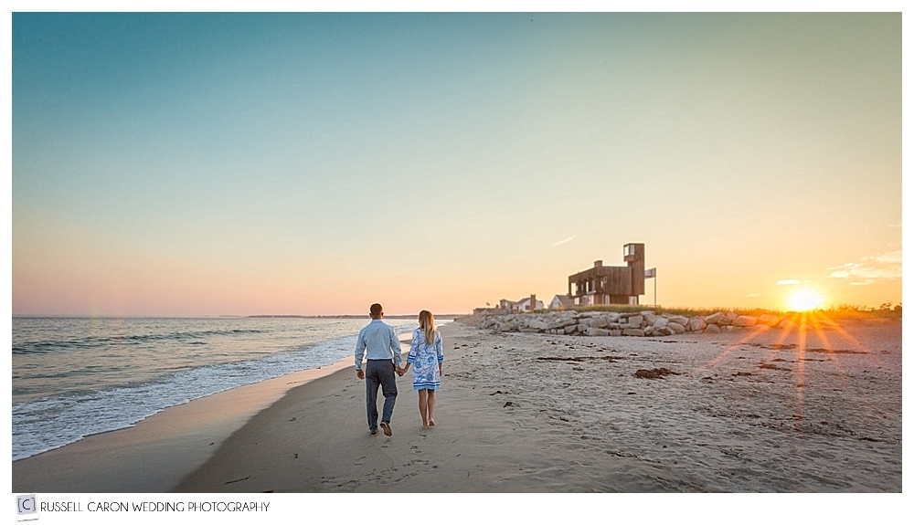 couple walking on the beach during biddeford pool engagement photo session