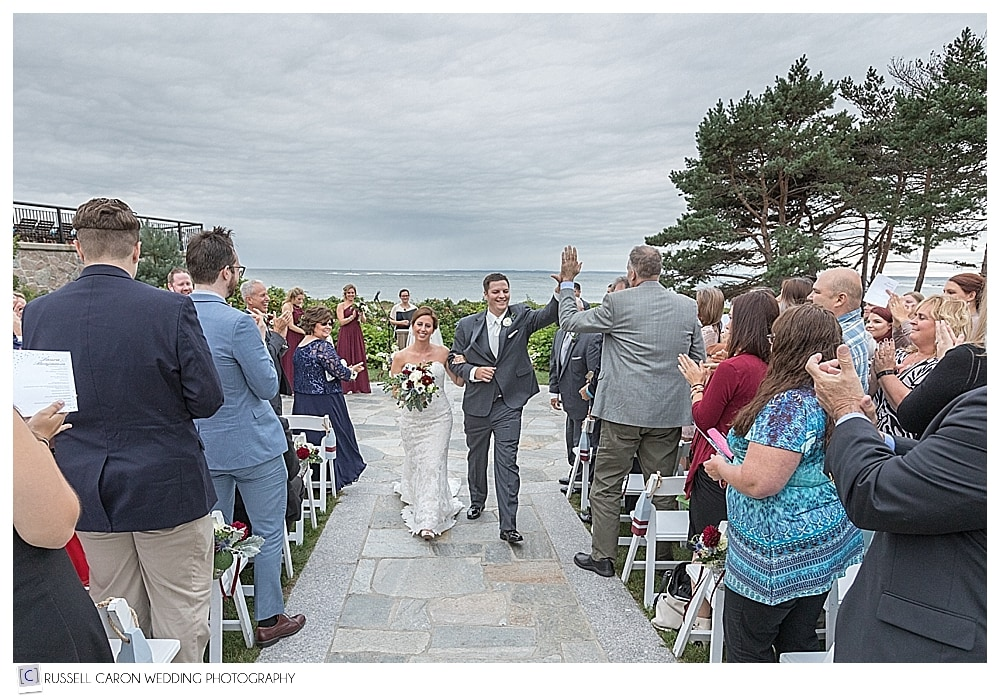 bride and groom during recessional during a classic Colony Hotel wedding in Kennebunkport, Maine