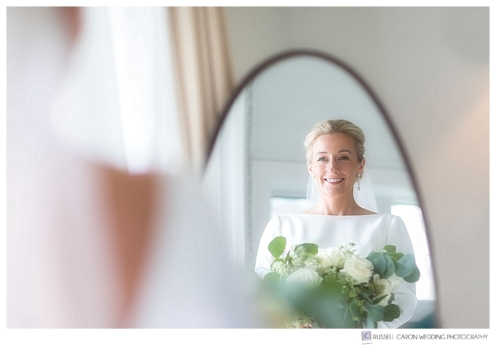 beautiful bride reflected in mirror