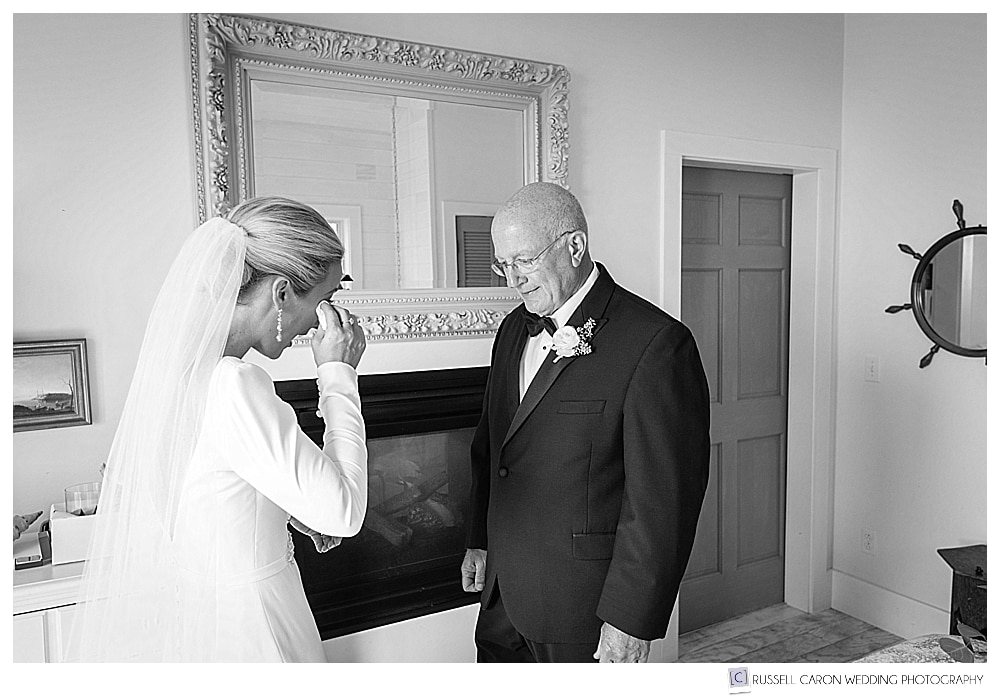 black and white photo of bride and dad's first look