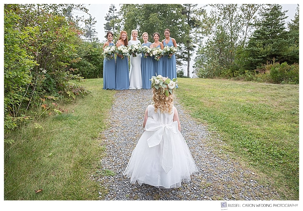 flower girls watching the bride and bridesmaids
