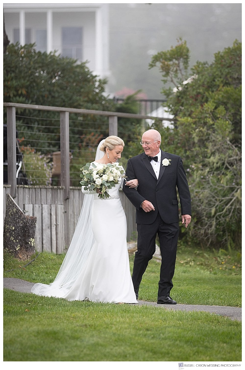 bride and her father getting ready to approach the groom at a classic Newagen Seaside Inn wedding ceremony