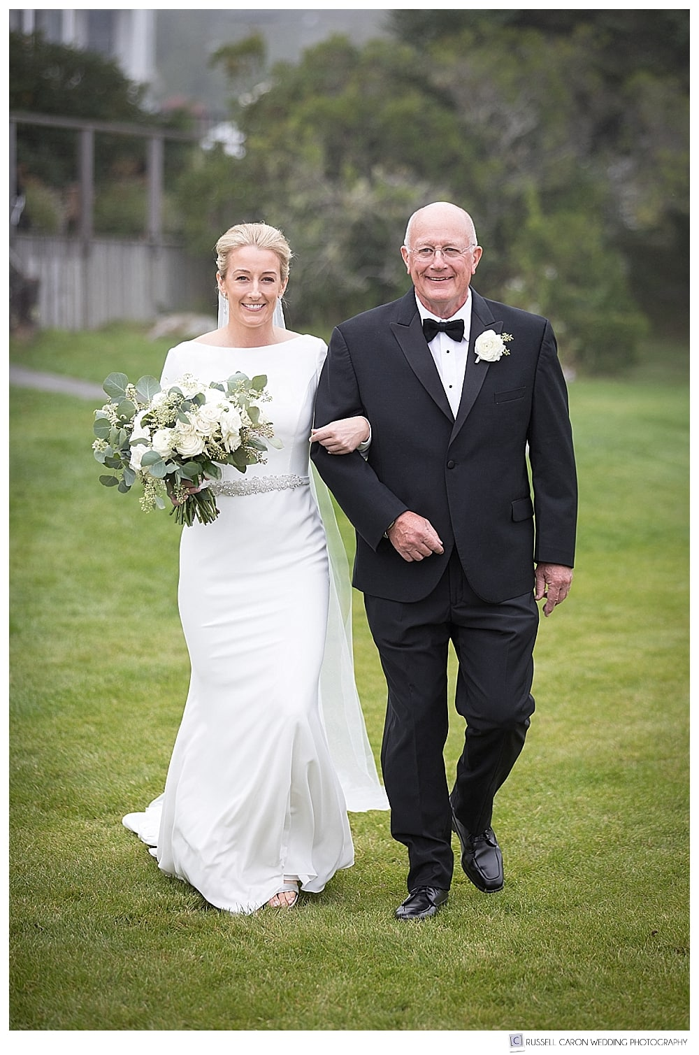 Bride and her father walking toward the groom at a classic Newagen Seaside Inn wedding outdoor ceremony