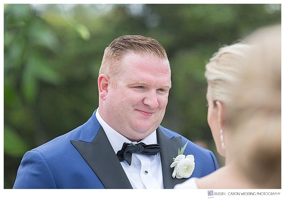 groom looking at bride during wedding ceremony