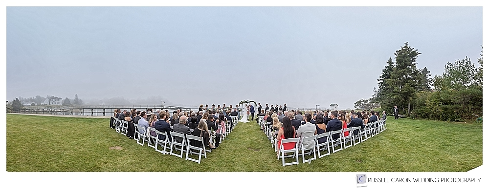 panoramic view of foggy, classic Newagen Seaside Inn wedding ceremony on the lawn
