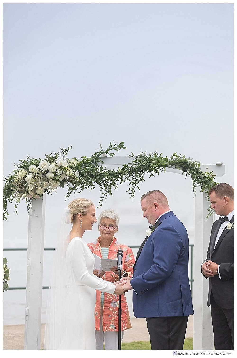 bride and groom during outdoor wedding ceremony at the Newagen Seaside Inn, Southport Island, Maine