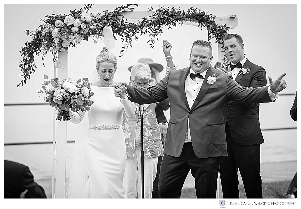 black and white photo of bride and groom just after their first kiss