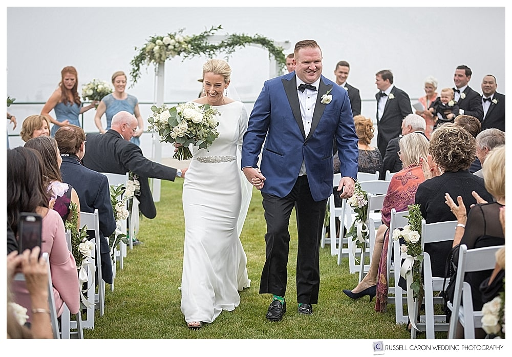 bride and groom during recessional at their classic Newagen Seaside Inn wedding ceremony