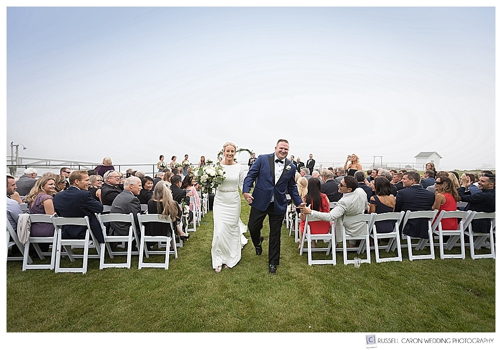 bride and groom finishing their recessional at their outdoor wedding ceremony