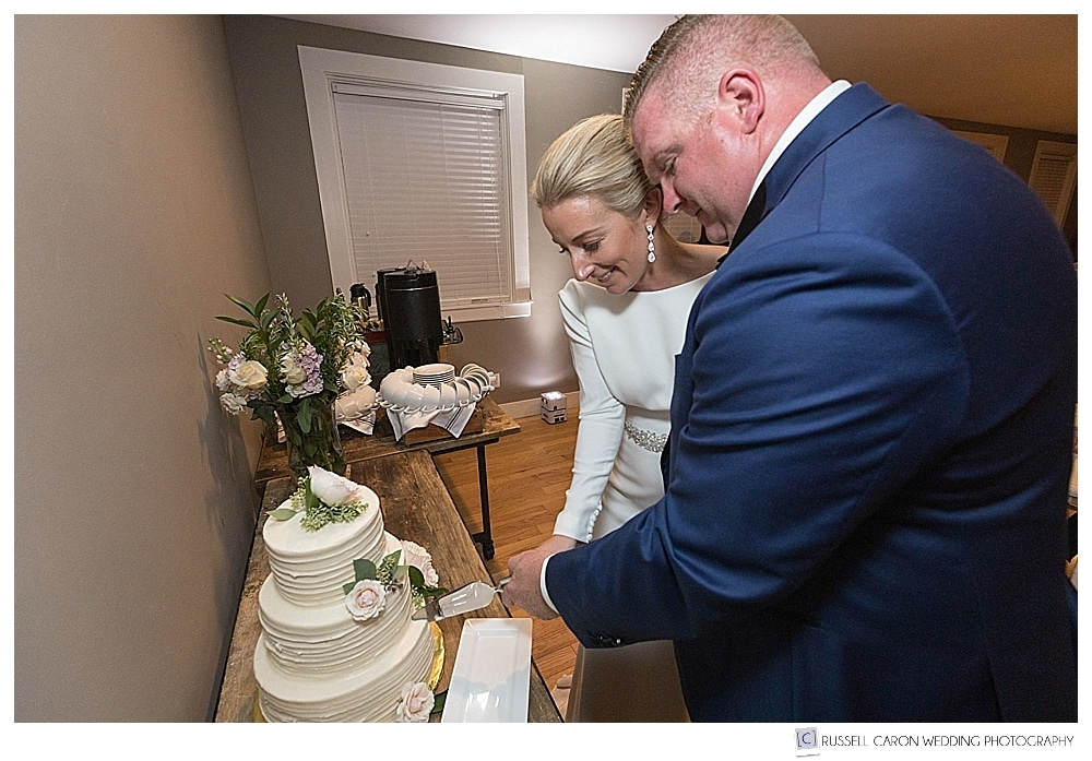 Bride and groom cut the cake by Nothing Bakes Like a Parrott