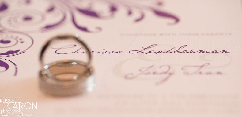 Wedding ring and wedding invitation photo