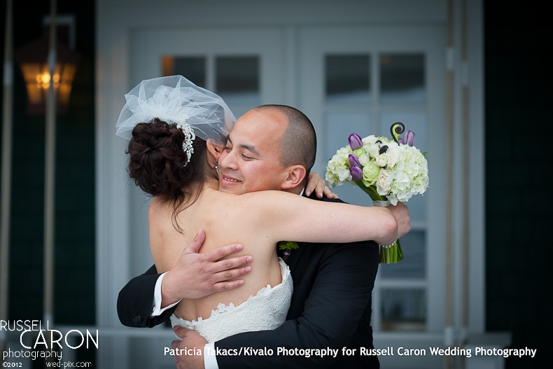 Bride and groom hugging at their wedding day first look