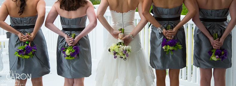 Bride and bridesmaids photo, back to with bouquets