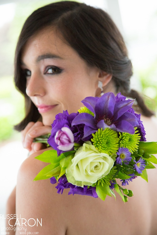 Bridesmaid with bright green and purple bouquet