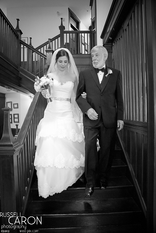 Bride and father of the bride descending the staircase at French's Point