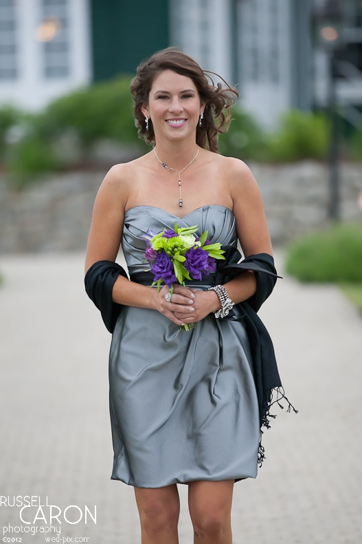 Bridesmaid during wedding ceremony processional at French's Point, Maine