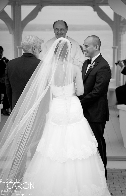 Father of the bride hands the bride over to her groom at a Maine wedding