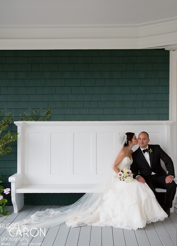 Bride and groom on the front porch at a French's Point wedding
